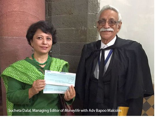 Sucheta Dalal with the compensation cheque